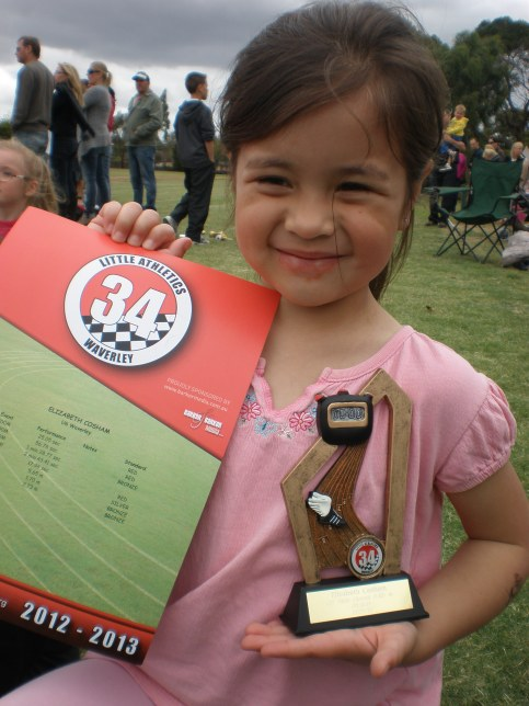 Elizabeth with her trophy and certificate